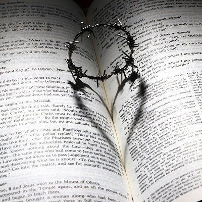 Image of the bible with a crown of thorns